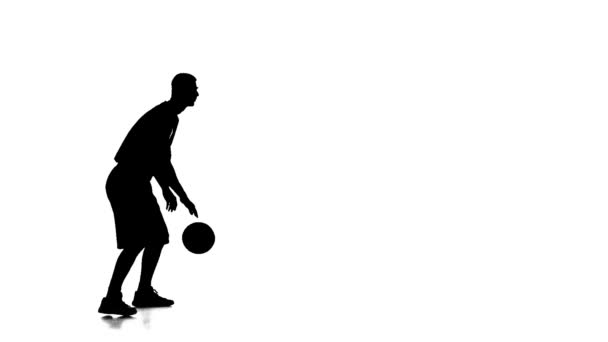 Basketball player fills the ball throws it forward. Side view