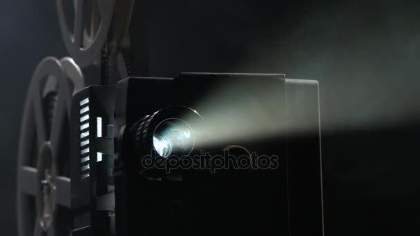 Shows movie in a projector. Close up