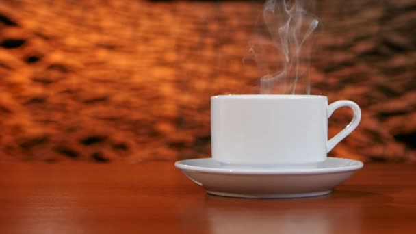 Cup on a white saucer of hot coffee on the aroma spreads room