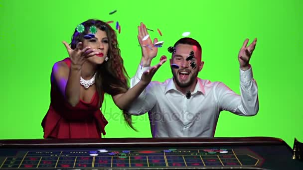 Žena a muž, hraní v kasinu vyhrát. Zpomalený pohyb