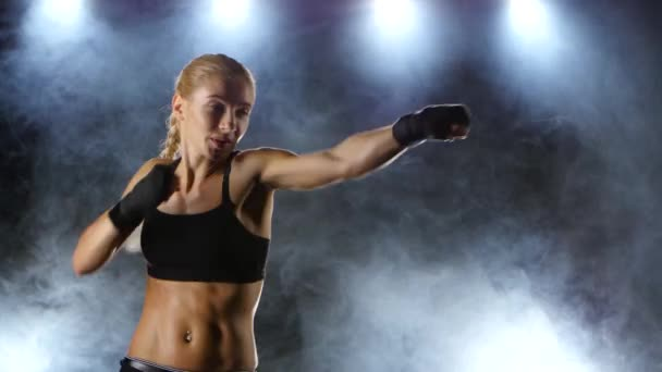 Training before the fight athletic girl boxer
