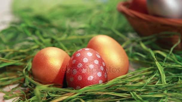 Chocolate rabbit among Easter eggs