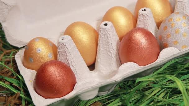 Hand lays golden easter egg