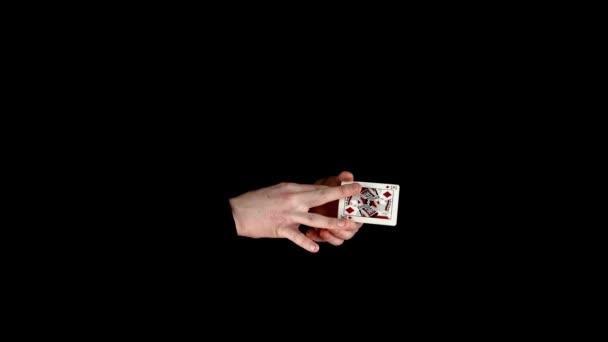 Trucco del mago con le carte, prendere carta da nessuna parte sul nero