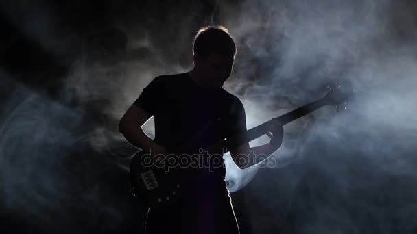 Fast tune bass guitar in the performance a musician man
