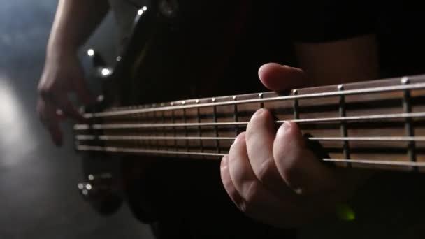 Closeup. Chord on guitar. Man strums and plays electric guitar ...