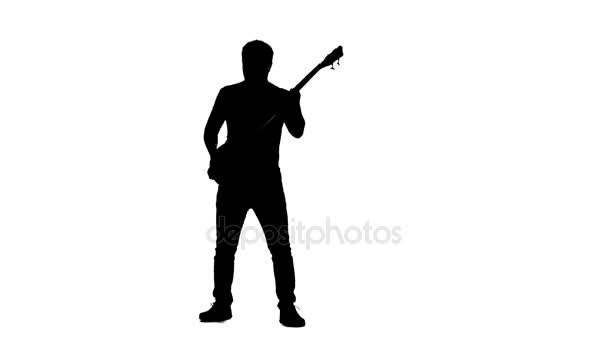 Man musician with bass guitar. Silhouette. Slow motion