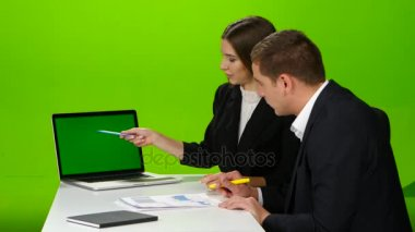 Colleagues discussing working moments in the office. Green screen