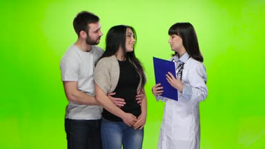 Young couple enjoys from the words heard from the doctor