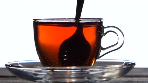 Closeup. Tea spoon stir the drink in a glass cup