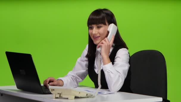 Woman flirting on the phone from the workplace. Green screen