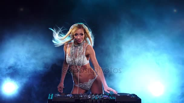 Luxury woman DJ in white underwear standing for mixing console