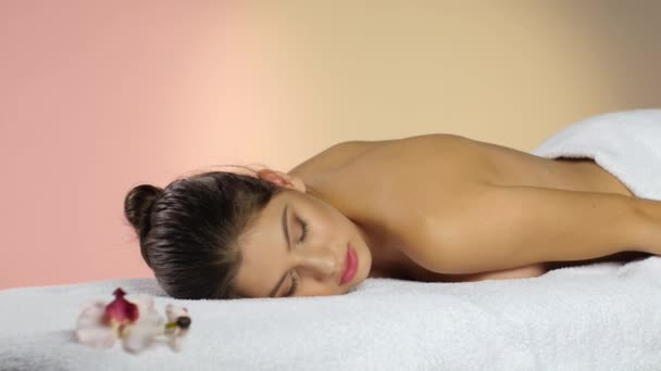 Girl sleeps on the white towels. Rest after spa treatments