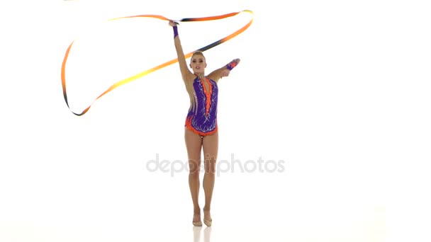 Flexible gymnast with tape creates beautiful hands graceful movements. White background