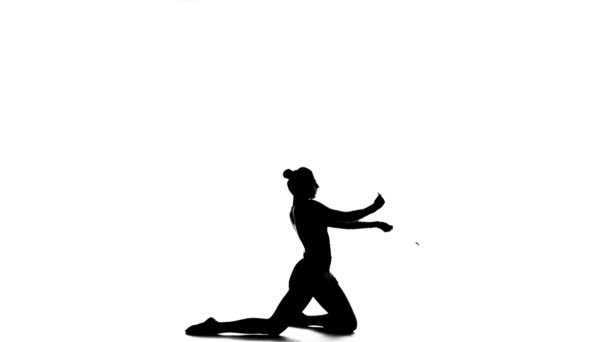 Gymnast holding a mace and professional bent. White background. Silhouette