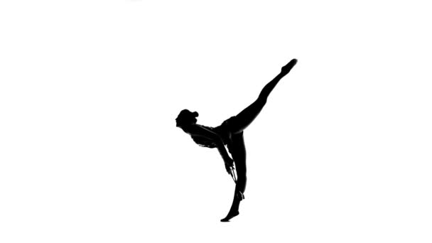Gymnast standing on one leg and holds a mace in his hand. White background. Silhouette