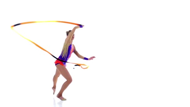 Flexible gymnast with tape creates beautiful hands graceful movements. White background. Slow motion