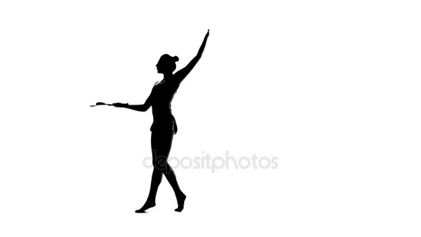 Gymnast mace toss up and juggling it. White background. Silhouette. Slow motion