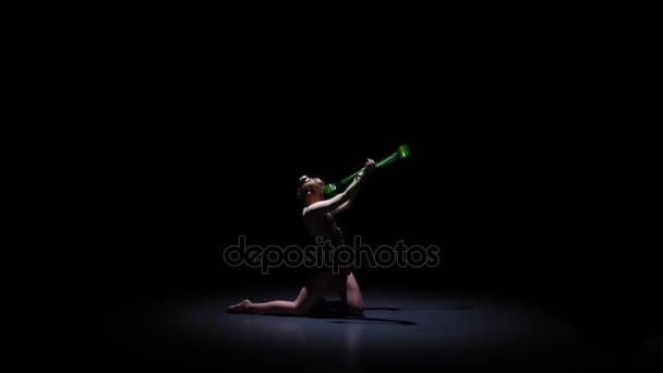 Rhythmic gymnast with mace nice moves. Black background. Slow motion