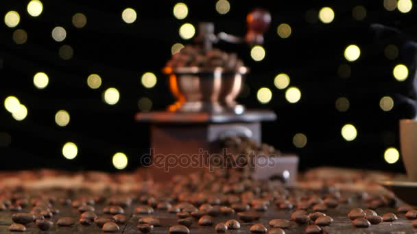Blurred shooting. Coffee grinder and cup hot drink with smoke