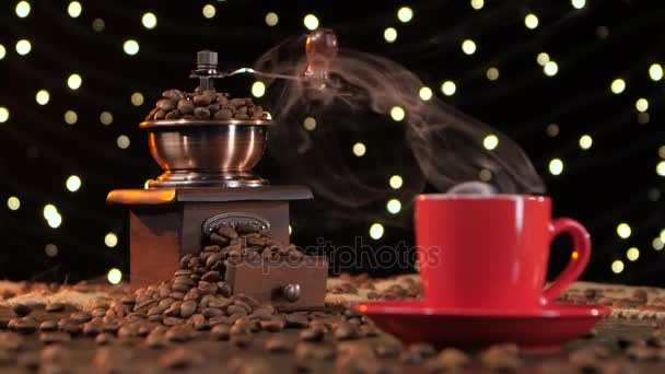 Coffee grinder filled with roasted coffee beans. Background with lights