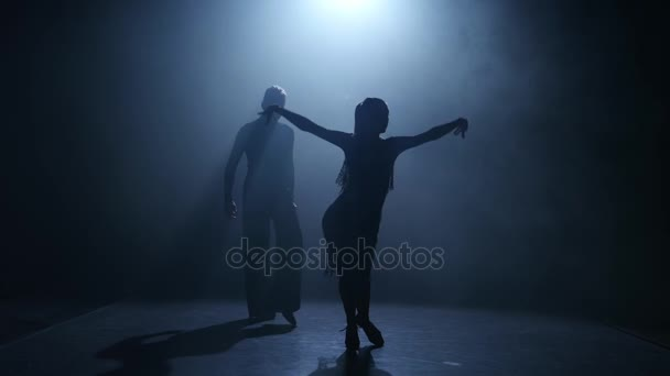Smoke background. Dance element from the jive, silhouette couple ballroom