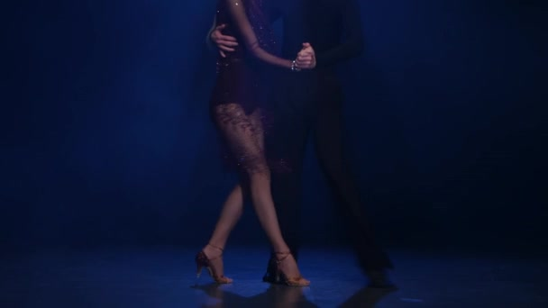 Couple dancers of jive posing on the floor, blue background