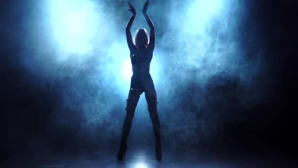 Slender blonde dancer in lingerie. Silhouette in smoky, slow motion