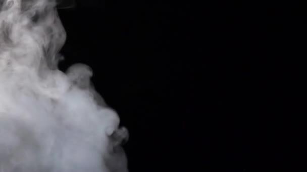Wave of white smoke on black studio background, slow motion