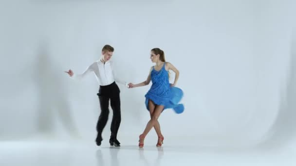 Couple of graceful dancers perform rumba on white background, shadow