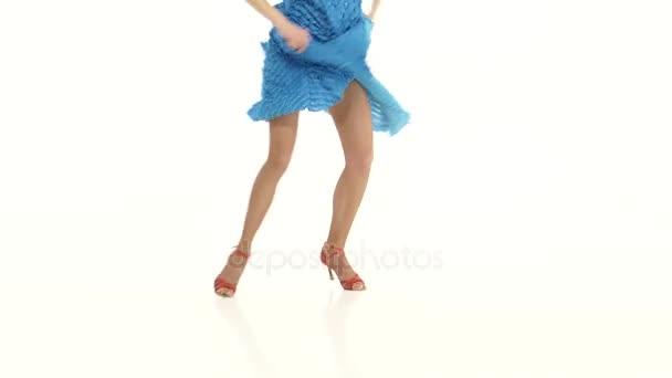 Legs of girl in ballroom dances. White background, close ups