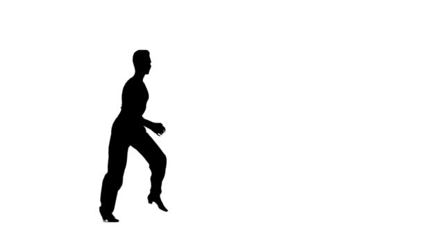 Solo man is dancing elements of ballroom. Silhouette, slow motion