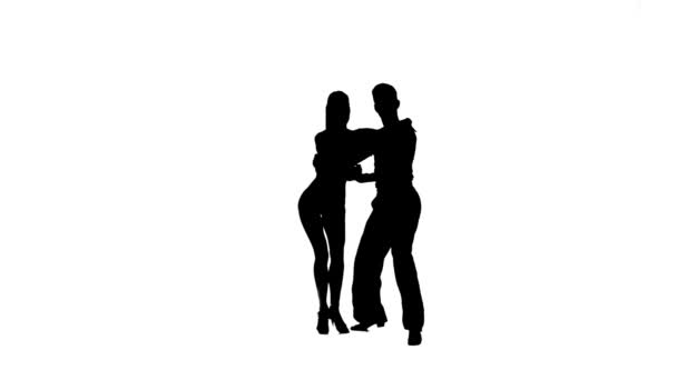 Silhouette couple professional dancers perform latino. White background, slow motion