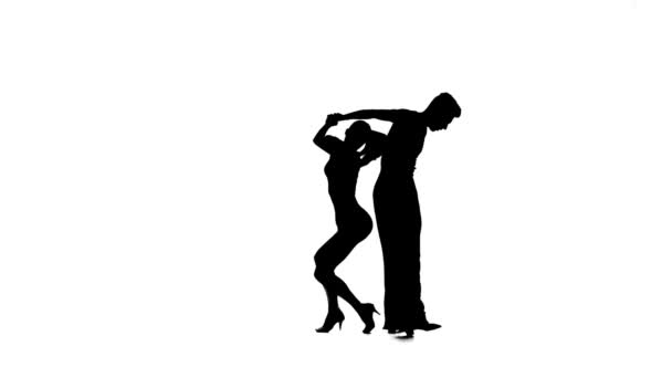 Silhouette couple dancers perform ballroom dance, white background, slow motion