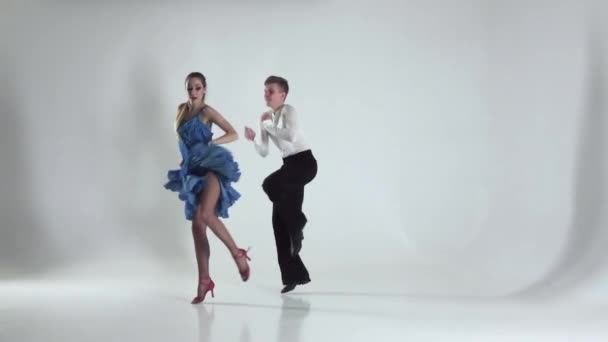 Couple is ballroom dancing on white background, shadow. Slow motion