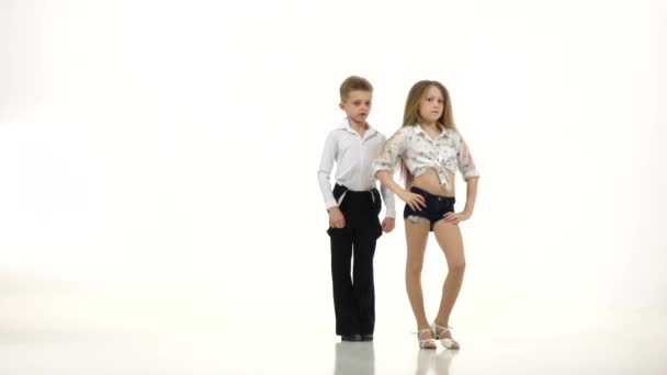 Children dance rhythmically latin american dance. White background. Slow motion