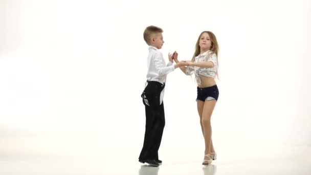 Child dance rhythmically latin american dance. White background. Slow motion