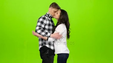 Lovers meet, join hands and spin, kiss, hug. Green screen