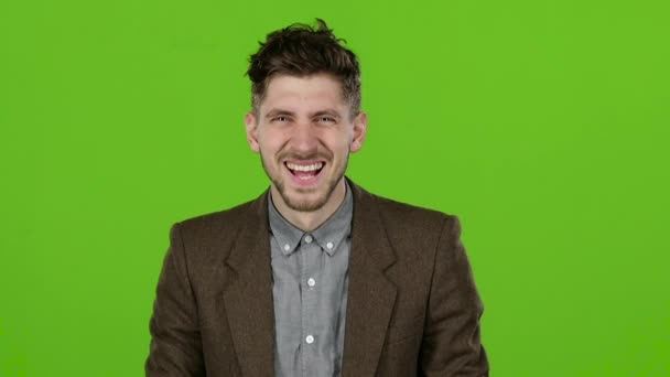 Businessman smiling showing them different grimaces. Green screen. Slow motion
