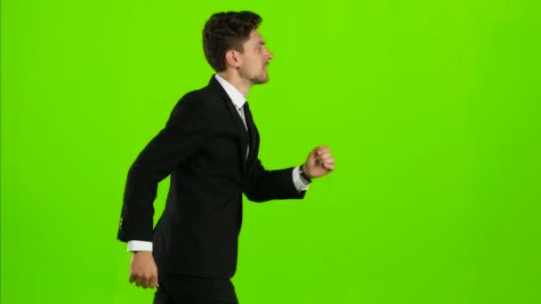 Unternehmer ist ein Telefon klingelt um ihn und er redet. Green-screen