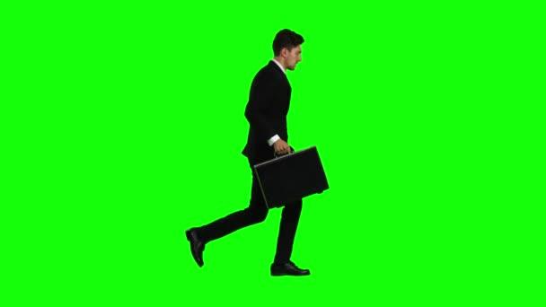 Der Mensch geht zur Arbeit, begreift, dass er zu spät kommt und beginnt zu rennen. Green Screen