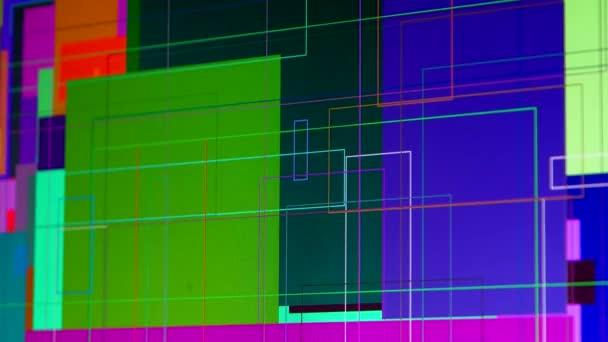 Vícebarevné grafické pruhy a trojúhelníky na monitoru počítače