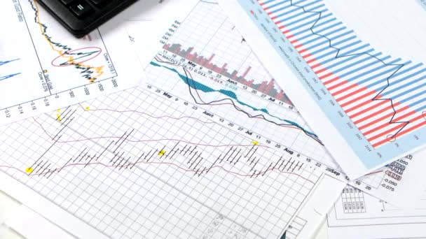 Businesswoman works with graphics on tablet and paper. Stock market
