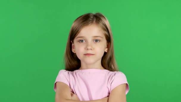 Child sighs heavily, she is tired. Green screen
