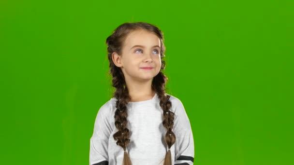Dítě-vlny ruku. Zelená obrazovka