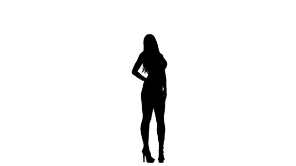 Fashion model is posing for a camera, for a magazine. Silhouette. White background