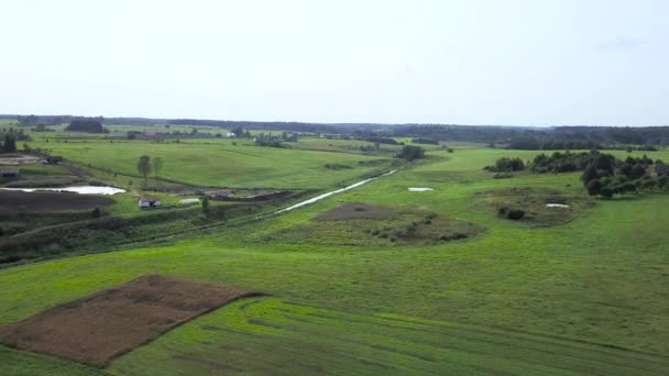 Endless fields meadows and forests in the country side. Aerial survey