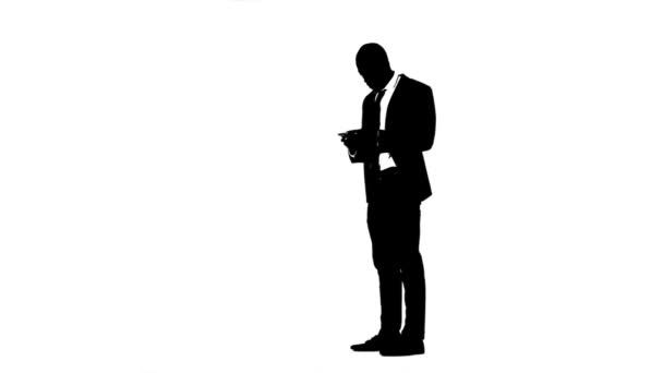 Business man decides by phone. White background. Silhouette