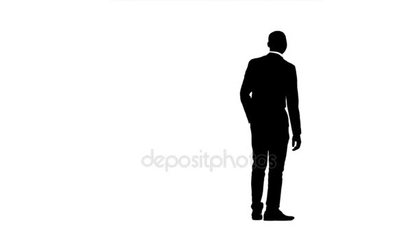 Man looks around and looks for something. White background. Silhouette