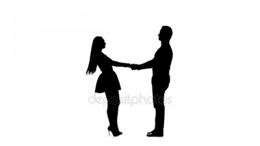 Guy takes the girl in his arms and kisses. Silhouette. White background. Slow motion